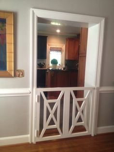 This would make a nice baby gate as well || LUCY WILLIAMS INTERIOR DESIGN BLOG: DOGGIE DOOR TO DIE FOR!!