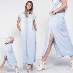 Light Washed Denim Dress 100% Cotton. Imported. Side slits and pockets. Dresses