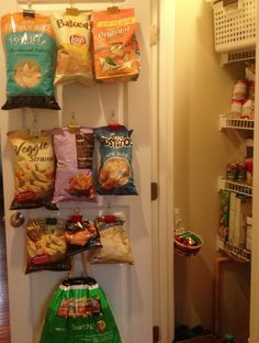 Chip bags hung by binder clips and 3M Command hooks.