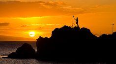 Torch Lighting Ceremony @ sunset. Black Rock on Kaanapali Beach, Maui