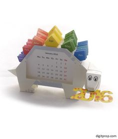Cute 2016 Dino Calendar for the desk. Make your own with the free printable from Digitprop!