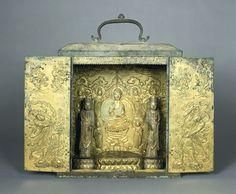 Portable Buddhist Shrine with Two Removable Standing Bodhisattvas, a Lotus Base for a Seated Buddha Image (now missing), a Repoussé Panel Depicting the Buddha Amitabha (Amit'abul), and Repoussé Panels on the Doors Representing Guardian Figures, 14th century Sculpture Korean , 14th century Koryô dynasty, 918-1392 Creation Place: Korea