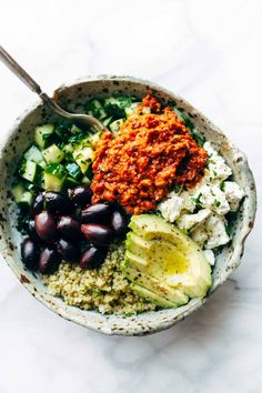 Mediterranean Quinoa Bowls with Kalamata olives and feta and roasted red pepper sauce. Pinch of Yum