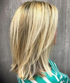 Medium Blonde Hairstyle with V-cut Layers