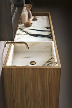 Marble inset sink, wood side, brass fixtures