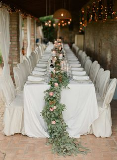 Garland draped tablescape: http://www.stylemepretty.com/2015/03/12/intimate-and-charming-wedding-in-tuscany/ | Photography: Greg Finck - http://www.gregfinck.com/