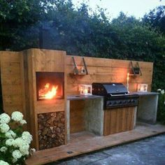 Outdoor kitchen with natural wood & stone