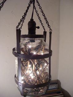 Hanging indoor or outdoor lamp my hubby made from an old pickle jar.  He made the frame at work, pop riveted sheet metal, painted a rusty brown.