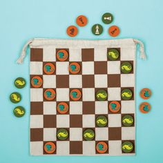 """Play two classic games on-the-go with Mighty Dinosaurs Chess and Checkers from Mudpuppy. 32 birch wood pieces feature classic chess symbols on one side and one of two ferocious dinosaurs on the other, all packaged in a travel-friendly drawstring bag with the game board silkscreened right on it! - 32 Double-Sided Birch Wood Game Pieces - Travel-Friendly Fabric Bag - Game Board Silkscreened on Bag - Perfect for Picnics and the Beach - Bag Package Folded in Half with Belly Band: 4.75 x 10.25""""…"""