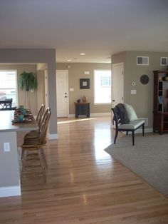 Gray walls with light/natural hardwood flooring