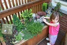 large outdoor fairy garden planter for kids to play in.