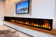 Linear Electric Fireplace using the Revolutionary ultrasonic technology Opti-Myst by Dimplex. The best alternative to the Gas Fireplaces. Handmade Cabinet Toronto. Fireplace with TV above.