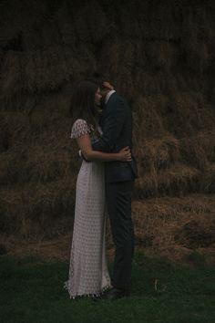 newlyweds hugging in the dark / Melissa Milis Photography