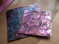 The faux metal is just tin foil glued onto a piece of card and then run through the cuttlebug.  Then painted with black acrylic paint which was rubbed off until the bright silver foil went all grubby.  Stazon inks in various colours were then rubbed on.