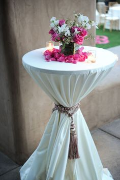 cocktail table with curtain ties for reception area, or since at the yacht club, old rustic looking rope?