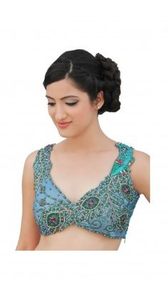 A V - neck saree blouse patterns adorned with dancing peacocks, embellished with Swarovski crystals and stones. For more detail visit  http://www.kbshonline.com/