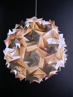 In modular origami, multiple geometric modules, each made from a single sheet of paper, are combined to form more complex models. Origami Modular, Geometric Origami, Origami And Kirigami, Origami Love, Paper Crafts Origami, Cardboard Crafts, Origami Lantern, Origami Lights, Geodesic Sphere