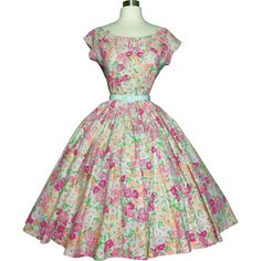 Fabulous and feminine 1950's dress Features include:  High quality Cotton fabric   Back metal zipper   Cut out design on chest with adorable bows  Two