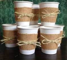 I like the white cups with burlap and twine
