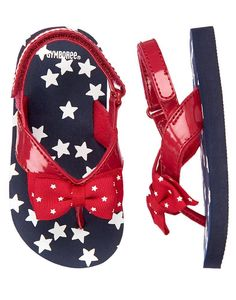 994d9453f5b Playful flip flop features grosgrain bows printed with stars on a bright  patent strap