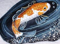 beautiful handpainted rock depicting a koi in a pond amid a burst of bubbles - love it!