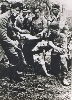 Jasenovac Extermination Camp (Croatia). Serbian prisoner being beheaded by Ustase guards/militia.