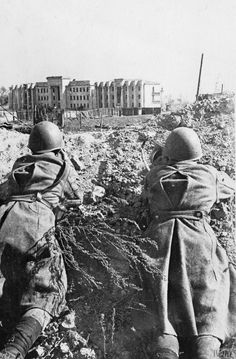 Soviet soldiers fire on German positions near the Soviet State Bank in Stalingrad, autumn 1942.