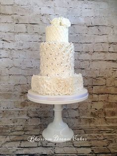 Ruffles & Roses white wedding cake