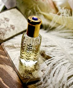 the bollywood bottle - natural perfume oil held captive in exotic 1/2 oz octagonal bottle with golden cap...silver cap version soon to come...