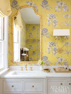 Home Tour: Elevated Charm In Buckhead, Georgia gold bamboo mirror in powder room with yellow floral wallpaper #wallpaper