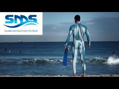 Scientists have designed a new type of camouflage wetsuit that is designed to make ocean swimmers invisible to sharks. Types Of Camouflage, Swimmers, Sharks, Scientists, Wetsuit, Ocean, Movie Posters, Shopping, Design
