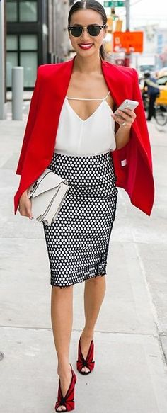 Professional yet fashionable take on the working suit. Love the red with the printed skirt.