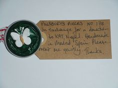 Pillsbury's Pieces No, 178. Pin with dark green capsule with white paper butterfly. In exchange for a donation to KATHMANDU ANIMAL TREATMENT CENTRE, Nepal. Available at St. George's Church, Madrid on Saturday 13 June from 11.00 - 15.00.