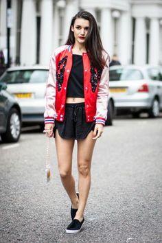 Anisa Sojka wearing red Topshop bomber jacket, black H&M cropped cami top, black H&M runner shorts, black fur Topshop skater shoes, and white Chanel phone case. #vfbestdressed