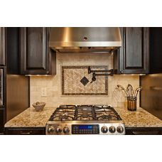 The tile insert with the pot filler is an amazing addition to his kitchen remodel.