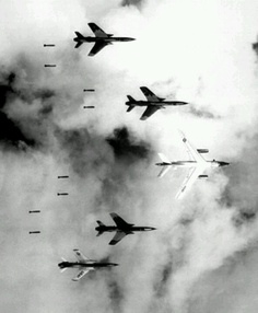 Four bomber jets in hostile land over Vietnam they dropping Naplam and bombs these bombs can detonate quickly and many civilians many be injured or dead form these weapons