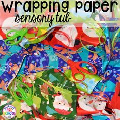 Wrapping paper sensory bin! My go to Christmas themed math, writing, fine motor, sensory, reading, and science activities for preschool and kindergarten.