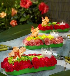 Fresh Flower Flip Flop™ Centerpiece  Make decorating for Summer parties a breeze. Your table will look gorgeous when you place these truly original, fashionably fun floral flip-flop centerpieces atop. Crafted by hand using vibrantly colored blooms, they come complete with glass votive holders and tea light candles to brighten up everything from Summer birthdays to luaus.