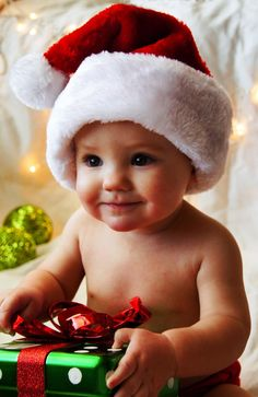 Christmas Baby Picture   santa hat lights and big colorful nTL4ksOQ