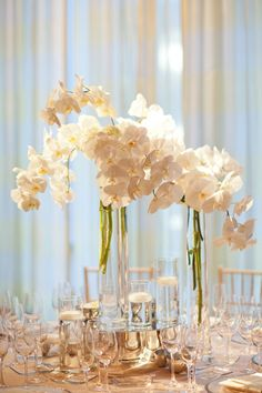 white phalaenopsis orchid centerpiece with 3 tall thin vases...is this too simple?