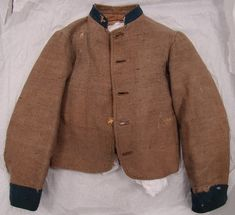 PictureElijah Crow Woodward's Columbus jacket is another example of an early Confederate depot uniform that pre-dates the end of commutation. Woodward served with Company C, 9th Kentucky Infantry. Artifact courtesy of the Kentucky Military History Museum, Frankfort, Kentucky.