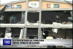 Destruyen pared de una ferreteria que impide el tránsito en el nuevo elevado de la rotonda de Cien Fuegos en Santiago
