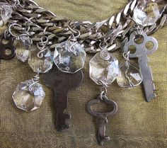 A friend of mine gave me this set of vintage keys for a birthday present.  She was slightly embarrassed because she thought they weren't worthy enough.  I on the other hand thought they were great and immediately created them into this urban chic bracelet with wire wrapped vintage crystals.  I love the industrial feel of this piece. It is currently offered at jryendesigns.etsy.com
