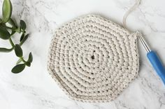 Combine cheap utilitarian twine (from Dollar Tree!) and a thrifted leather belt to create a raw, yet upscale home decor piece. Free crochet pattern!