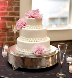 """All buttercream, fresh peonies. Very vintage chic I think. 12/9/6 inch round cakes. The """"beads"""" or """"pearls"""" are all buttercream as well, piped w/ tips 12, 8, 5, and 3. The cake was refrigerated prior to delivery, so there is some """"sheen"""" on the cake from the very slight glisten of condensation."""