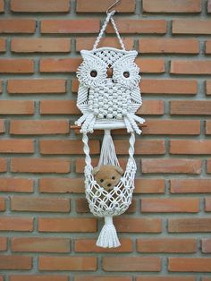 """Macrame wall hanging 'White Owl and its Nest', a beautiful piece of handiwork macramé, made of poly cotton (cotton + polyester) twisted cord in off-white color and wooden beads, the nest is used for mini storage. Size: 7½"""" width x 19"""" Length (19.0 x 48.0 cm- the length not include its hanger) Shipping: I ship worldwide, the item will be shipped within 5-7 business days of receiving payment. The standard method is registered air mail (by Thailand Post), typically delivered within 7-14…"""
