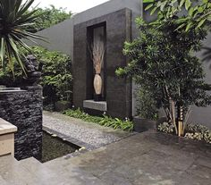 Sleek, contemporary courtyard with a touch of zen. A hugh vartiety of textured finished all dark grey and charcoal create various areas of interest.