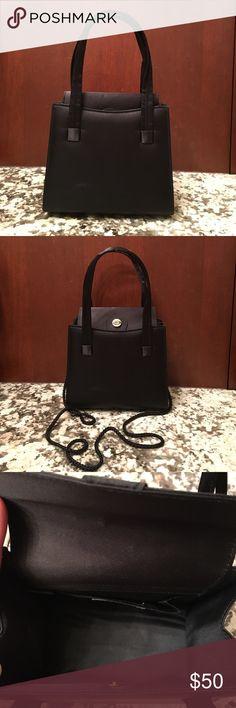 Black formal handbag Pre-owned Black formal handbag. Also hideaway shoulder strap. Amanda Smith Bags
