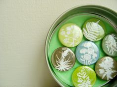 Woodland Magnets in a Tin - Set of Seven in Greens and Browns. Floral Botanical Papercut Designs. From KitzieG at Etsy $12.50