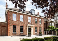 New Build Period house in St John's Wood London, two storey house over double basement, beautiful mixed stock brickwork with red brick detailing and stone portico and dental.